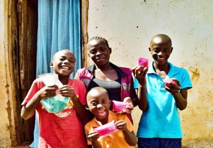 Lizzie and her children Mathews, Given and Trust now have the soap they need to protect themselves in Malawi. Photo: Concern Worldwide.