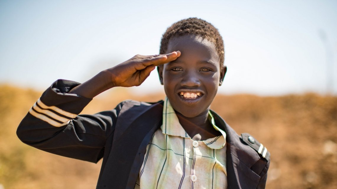 Jantik, a young boy living in the PoC of Juba, South Sudan smiles at the camera. Photo: Steve De Neef/Concern Worldwide.