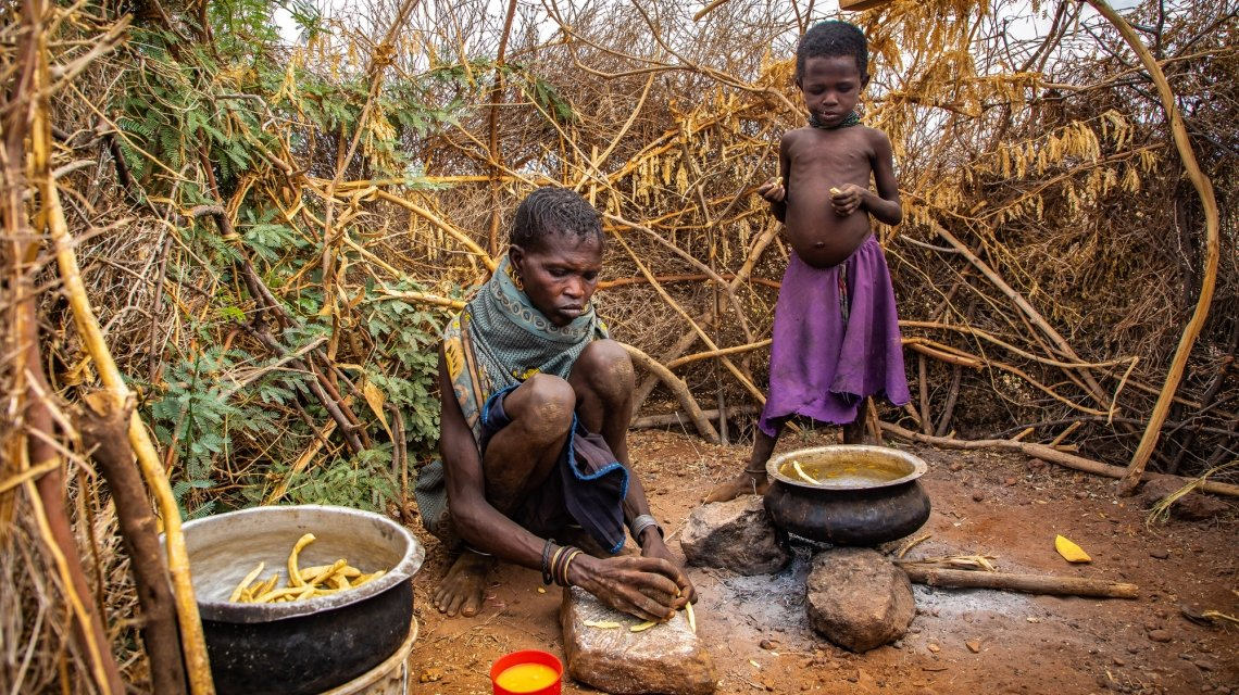 Ng'ikaro prepares the wild fruits that have become her family's sole source of nutrition during drought in northern Kenya. AS pastures have dried up her herd of goats have been wiped our and the few that remain are no longer able to produce milk. Photo: Gavin Douglas / Concern Worldwide.