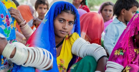 17 year old girl local girl looks into the camera, in a village near Umerkot. Photo: Black Box Sounds / Concern Worldwide.