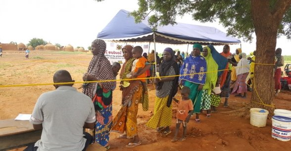 Women queue to be registered before receiving their rations in Falali Village.  Photo: Ciara Hogan / Concern Worldwide.