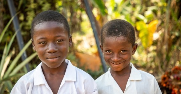 Brothers Darry (9) and Sala (7) from Toe Town, Liberia. Pictured here in their school shirts. These brothers benefit from a new water pump constructed by Concern Worldwide. Photo: Gavin Douglas / Concern Worldwide.