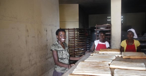 Christela Louis inside the bakery, supported by Concern, where she has worked since May. Christela is confident that through working here, she will be able to grow her business and start saving money. Photo: Kristin Myers / Concern Worldwide.