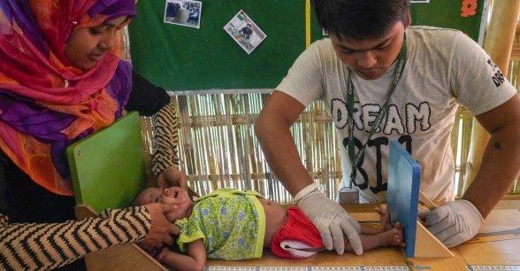 Concern staff in Cox's Bazar screen Azara* for malnutrition. Photo: Abir Abdullah / Concern Worldwide.