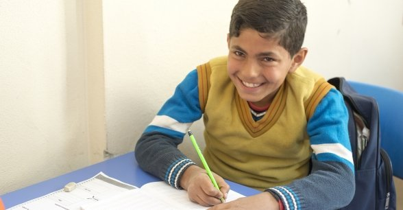 Osama, 12, strengthens his Turkish language skills at a Concern Education Support Centre in Sanliurfa Province, Turkey. Photo: Concern Worldwide.