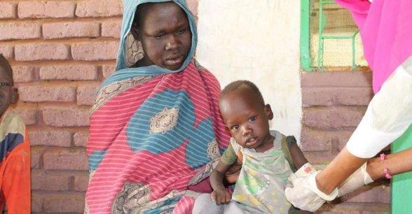 A child is measured for malnutrition in Muglad, West Kordofan.