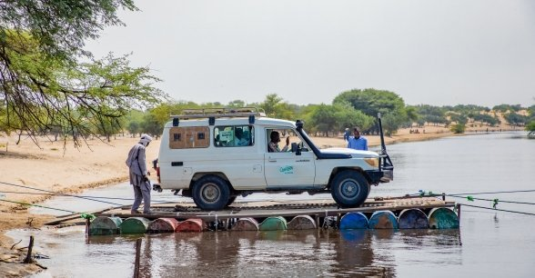 A Concern mobile health clinic rafts across a river to reach remote communities in the Lake Chad region.
