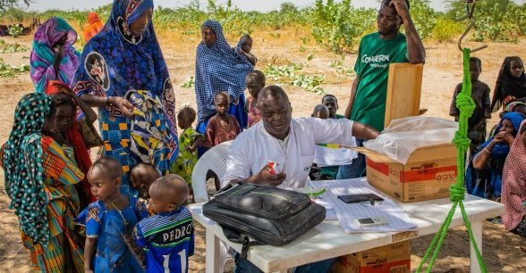 A Concern mobile clinic team in Chad distributes therapeutic food which is used to treat malnutrition.