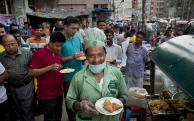 Zafar serves food from his food cart, Bangladesh. Photo: Abbie Trayler-Smith / Concern Worldwide.