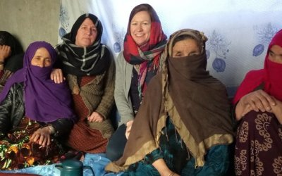Concern staff member Rosaleen Martin and Community Development Facilitator Taza Gul with a women's self-help group in Chaab district, Afghanistan. Photo: Rosaleen Martin / Concern Worldwide.