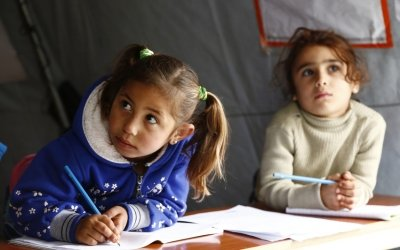 Farah* and Nadia* attends a non-formal education programme in an informal settlement that focuses on early childhood education in Akkar, north Lebanon. Photo: Chantale Fahmi/Concern Worldwide.