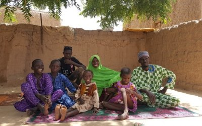 Ibrahim Abdou, a member of the Husbands Schools, with his family. Photo: Ciara Hogan / Concern Worldwide.