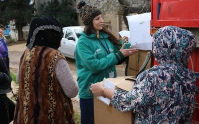 Concern staff member Amani Sahmarani distributes emergency supplies in Lebanon. Photo: Concern Worldwide.