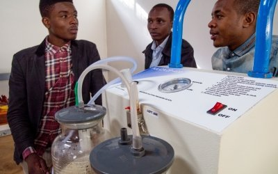 Engineering students with a suction machine they designed for clearing a newborn's airwaves. Photo: Concern Worldwide.