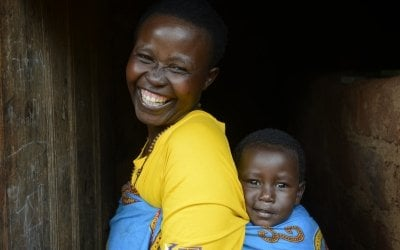 Elisabeth Ntakarutimana (35) with the youngest of her six children, 20-month-old Odelie Joyeuse. Elisabeth is a Care Group Volunteer, supported by Concern, and supervises 16 mothers who live close by – visiting three families every morning. Photo: Chris de Bode / Concern Worldwide.
