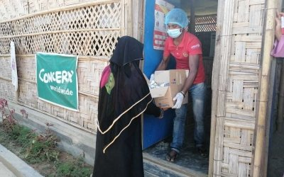 Hamida* receiving Nutritional Supplement for her malnourished child from a Concern supported Nutrition site, Cox's Bazar.