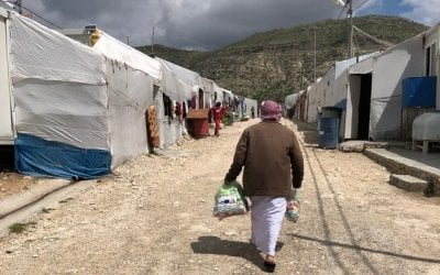 A man keeps a social distance from others as he returns home after receiving a hygiene kit in a camp in Northern Iraq. Photo: Concern Worldwide.