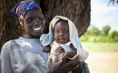 Agel and her baby Kuek were struggling with malnutrition in South Sudan. Concern taught Agel how to grow a vegetable garden. Photo: Abbie TraylerSmith / Concern Worldwide