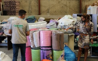 Concern's Warehouse Manager, Mohammed along with Sawsan and Miriam from a local volunteer group, do a stock take of blankets. Photo: Jade van Huisseling