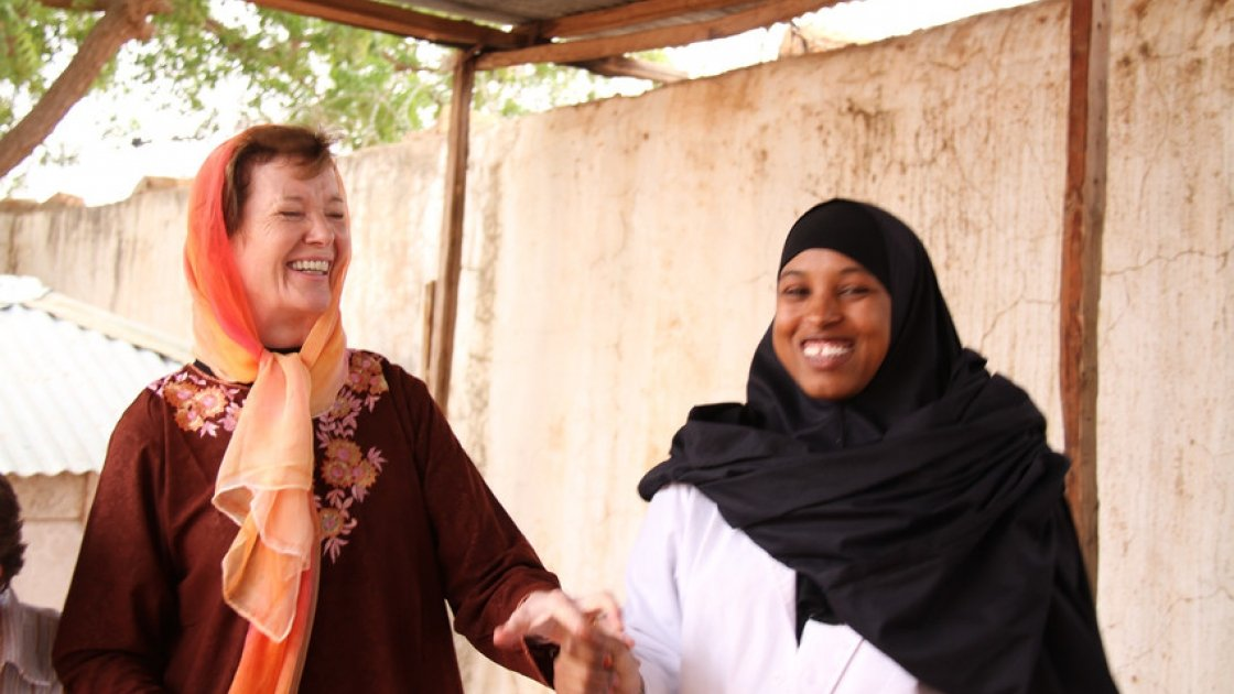 Mary Robinson with healthworker Nadhifa Ibrahim Mohamed. She has worked in Dollow Health Centre  for 3 years and is a certified midwife, Dollow, Somalia. The Somali district of Dollow is situated on the Somali / Ethiopian border.  Dollow town, the district capital, is the border crossing point and is contiguous with Dollow Ado on the Ethiopian side. Dollow is a key transit point between Somalia and Ethiopia in the current crisis with over 1,700  crossing between the two countries on a daily basis. To date 7