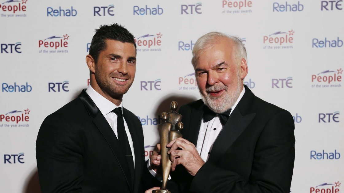 Tom Arnold, pictured with Irish International Rugby Player, Rob Kearney after he received his 2013 People of the Year Award at the 39th Annual People of the Awards Ceremony organised by Rehab held in the CityWest Hotel, Co. Dublin. Photo: Robbie Reynolds.