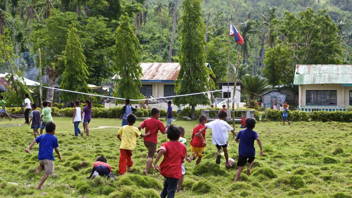 Children at the elementary school in Polopina play soccer