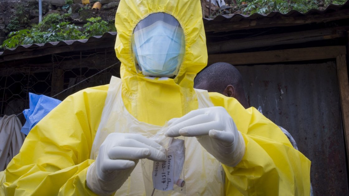 """A member of """"Burial Team 7"""" removes a swab from a 44 year old woman. Photo: Concern Worldwide"""