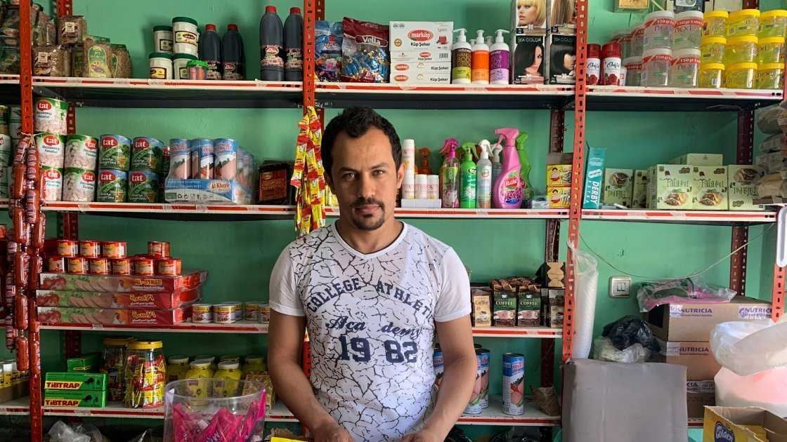 Bassam pictured in his shop in Turkey