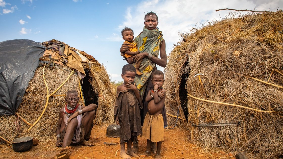Ng'ikario Ekiru with her mother-in-law Nakode and three of her children, Aukot, Ekuam and Apua. The family from Turkana county  in northern Kenya have lost almost their entire herd of goats to recurrent droughts and are relying on wild fruits for their survival.Photo: Gavin Douglas / Concern Worldwide.