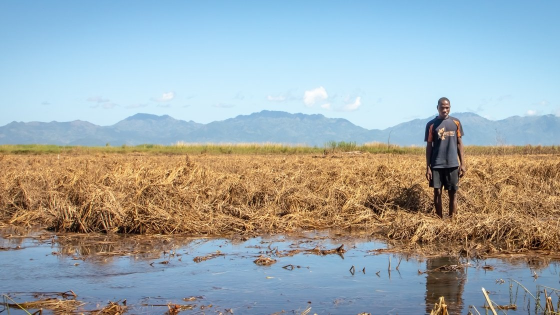 Patrick Ghembo of Monyo Village, Malawi, standing in his field, destroyed by floods. Photo: Concern Worldwide.
