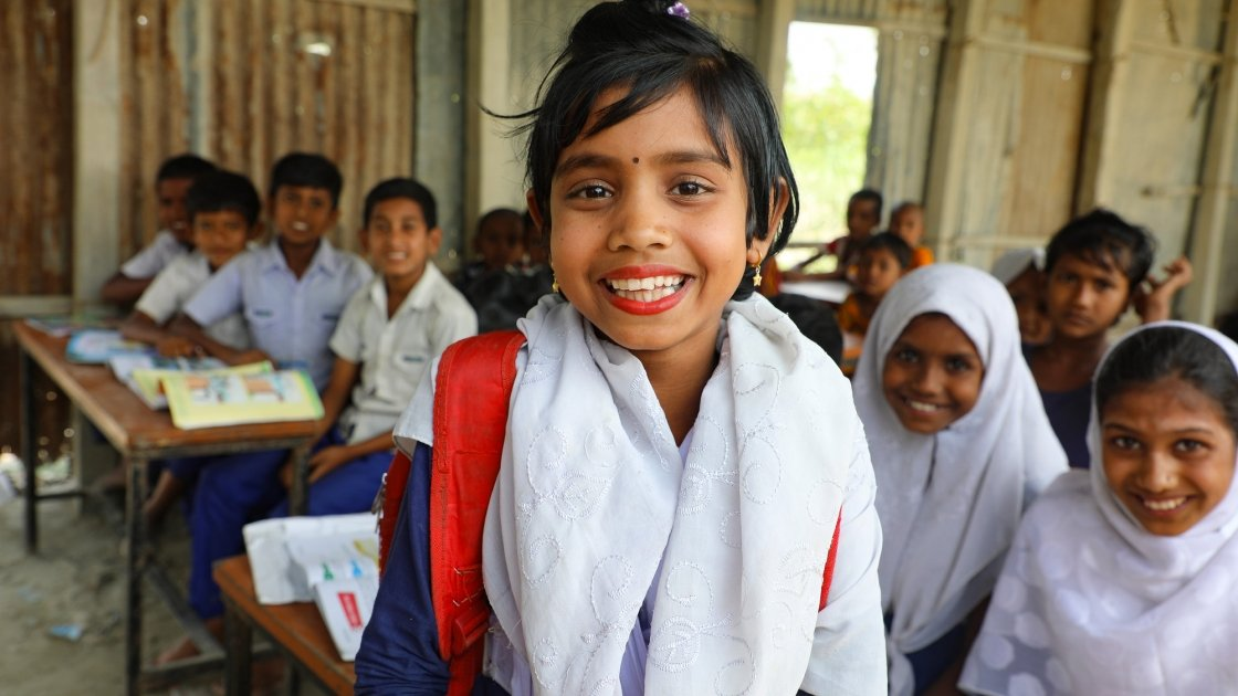 Saliha* (7) attends school at the newly repaired school on one of the Char islands severely affected by recent floods. Photo: Jennifer Nolan / Concern Worldwide.