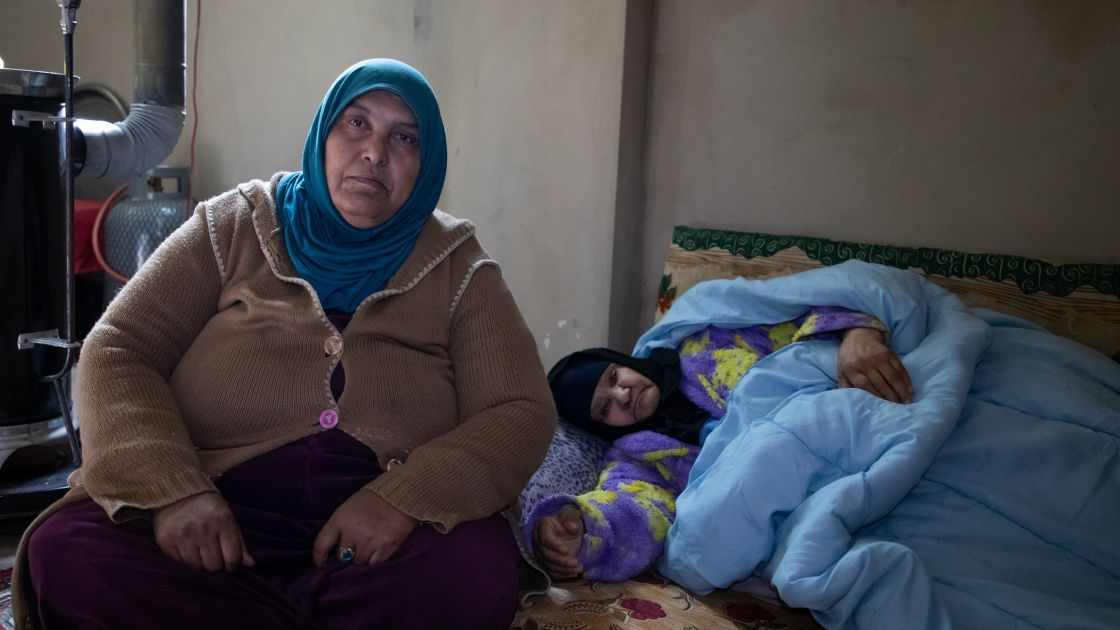 Fada* (60) with her mother Esma* (82) living in their garage.