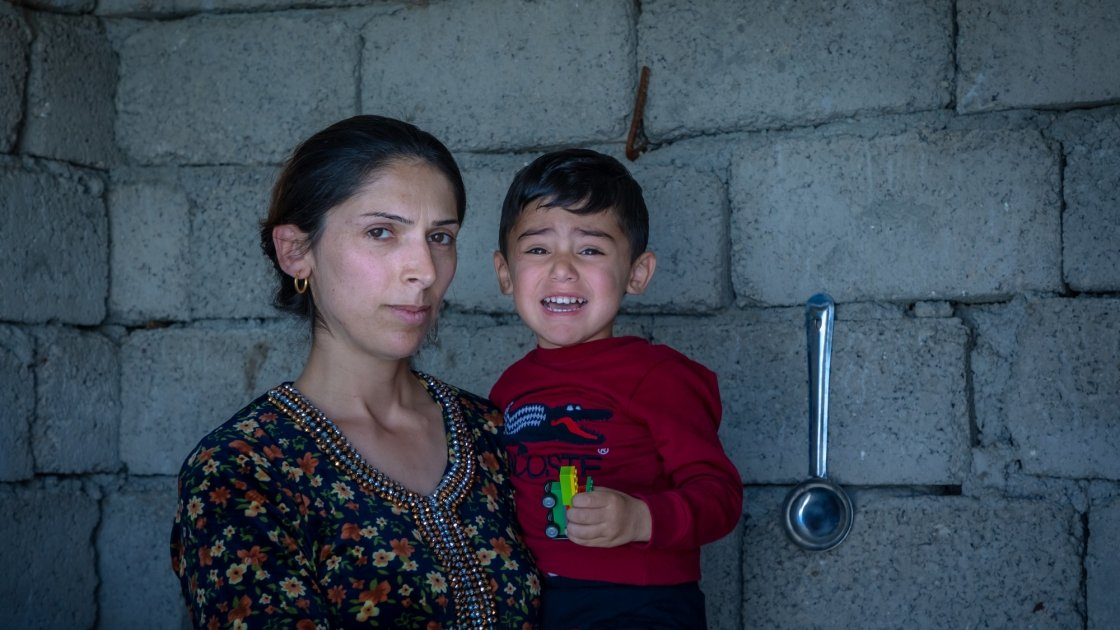 Mother Amal with her youngest son Hevi (3) at their home in Iraq. Photo: Gavin Douglas/Concern Worldwide