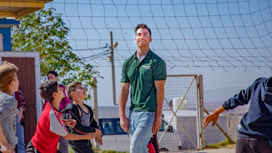 Dublin footballer and Concern Ambassador Michael Darragh Macauley playing volley ball with Syrian refugee children. Photo: Gavin Douglas/Concern Worldwide