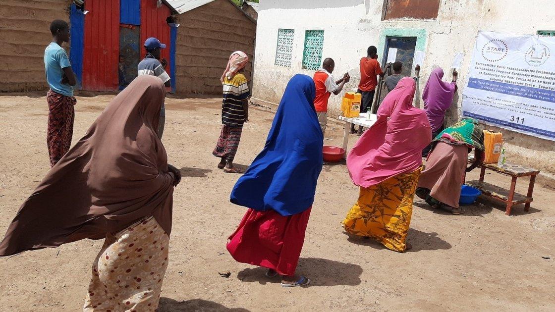 Cash transfer recipients in Somalia register their information.