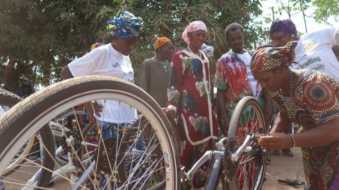Influential women and traditional healers bicycle maintenance training session.