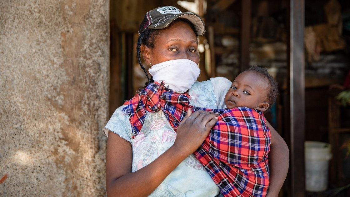 Baby Charlyne and Margret Wanjiru in the alleyway outside there home in Kibera. Nairobi where she lost her livelihood and needs urgent food aid to survive