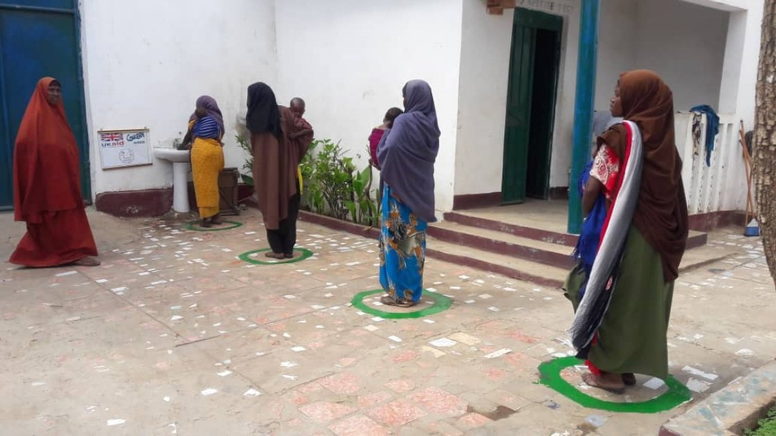 In light of COVID-19, health facilities have implemented new measures to separate people while seeking services such as controlled patient pathways from one area to the next. A key feature has been to include ample hand washing stations. Concern's partner, SHACDO has been raising awareness about the importance of proper hand and cough hygiene in combination with demonstration hand washing classes for both staff and patients. Somalia. Photo: Concern Worldwide