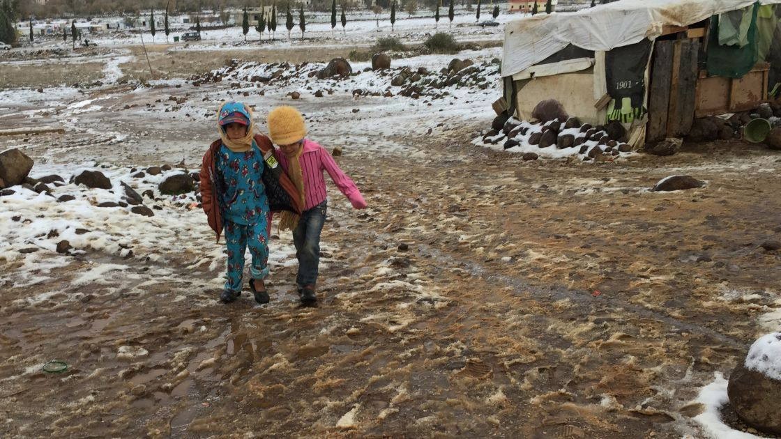Children playing in the snow at a camp in Lebanon.