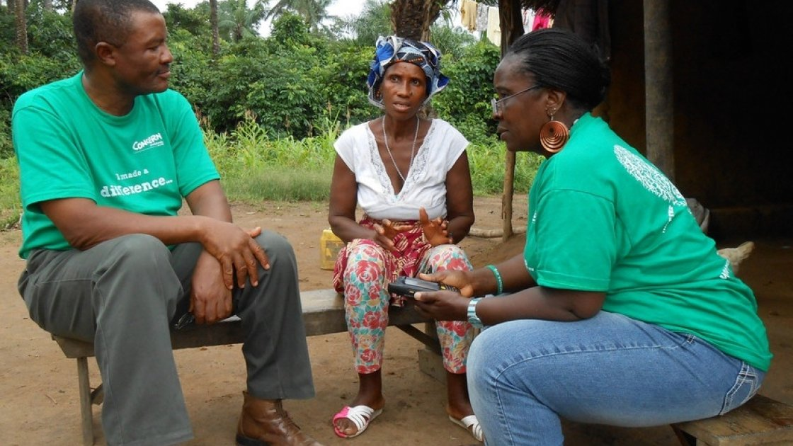Theresa Maurice Ojong – M&E Officer, Child Survival Programme & Albert Yanguba - Operations Research Advisor, interviewing Aminata Mansaray – beneficiary in Baoma Village, Waterloo, Western Area, Sierra Leone for live data collection. Photo: Ciarán Walsh / Concern Worldwide.