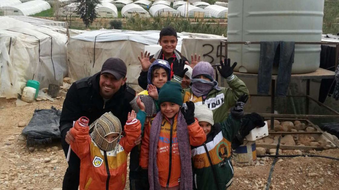 [alt: Children wear newly-distributed winter clothes, 13th January 2015. Photo taken by Concern Worldwide]