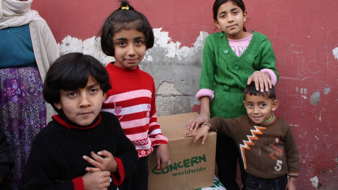 Young Syrian children pictured with supplies from Concern.