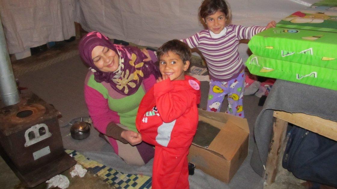 Syrian refugee children receive winter clothes from Concern. Photo: Amanda Ruckel / Concern Worldwide.