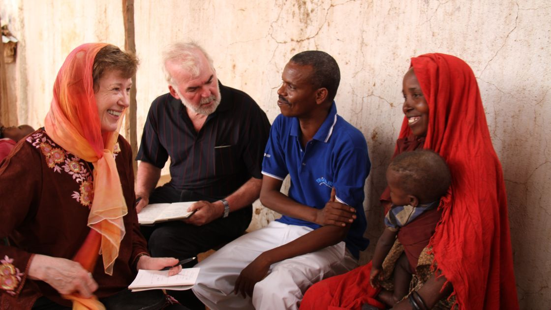 Former Irish president, Mary Robinson and former Concern CEO,Tom Arnold, meet Barey Mohamed Abdirahman and four-year old Farhiya Adbi Billow at Dollow Health Centre,  Somalia. Photo: Jennifer Nolan, Somalia, 2010.