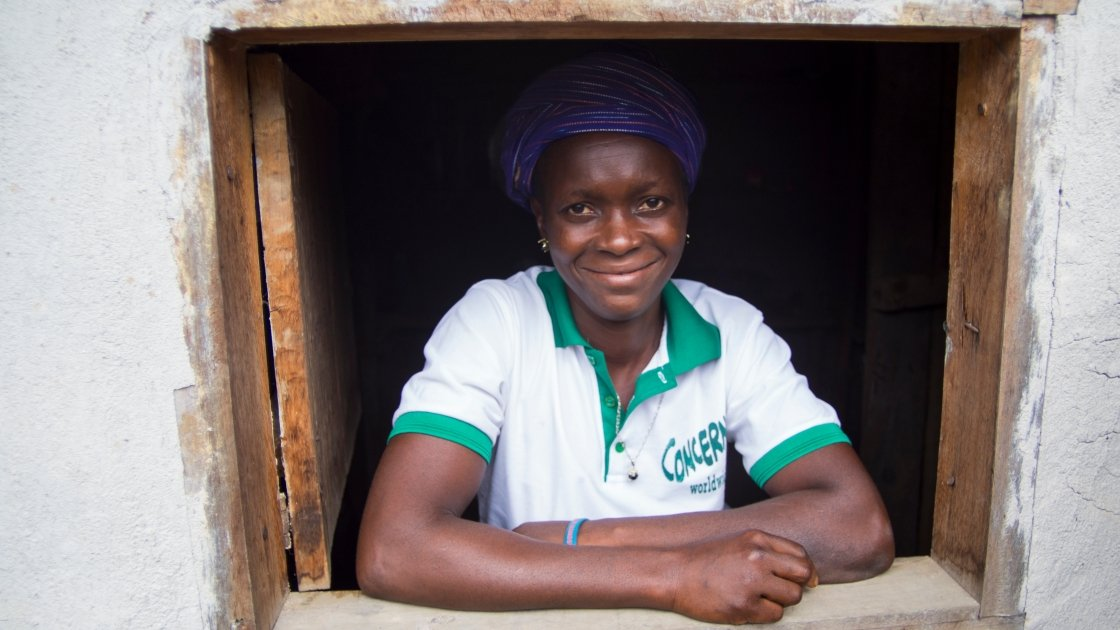 Varbah Jenneh at her shop in the village of Dadazu, Lofa County, Liberia. Varbeh started the shop with loan from the local CSLA. Photograph taken by: Kieran McConvillle/Concern Worldwide