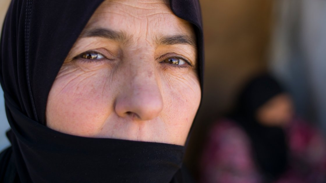 Fatme*, a Syrian woman living in an informal tented settlement in northern Lebanon. Her family left their home with no possessions, not even their IDs, when it was bombed. Photograph taken by Kieran McConvillle/Concern Worldwide.