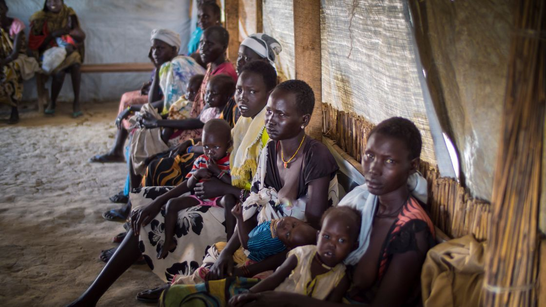 Women wait with their children for treatment at one of the Concern nutrition centres in Bentiu Protection of Civilians (POC) site in Unity State, South Sudan. Photograph taken by: Kieran McConville/Concern Worldwide.
