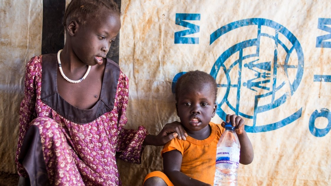 Khamis Yohnes in orange, pictured with his older sister Dukan, was a newborn baby when the current conflict in South Sudan broke out. His family moved from place to place seeking protection and are now living in the Protection of Civilians (POC) site at the UN base in Juba. Photo: Kieran McConville/Concern Worldwide 2016.