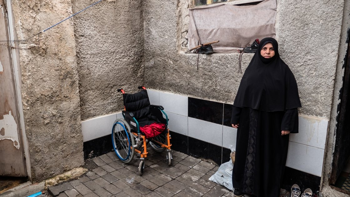 Leena (47) stands outside her rented accommodation in Turkey. Photographer: Kevin Carroll/Concern Worldwide.