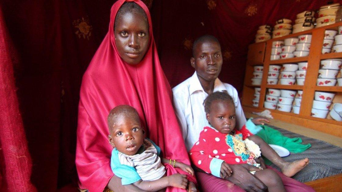 The Hassane family sit in their small house. Baby loubaba is severely malnourished and is attending a Concern Worldwide supported health centre in Commune de Bambaye, Tahoua, Niger for treatment. Photo: Jennifer Nolan / Concern Worldwide.